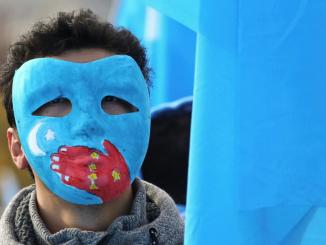 Uighur Man in Demonstration